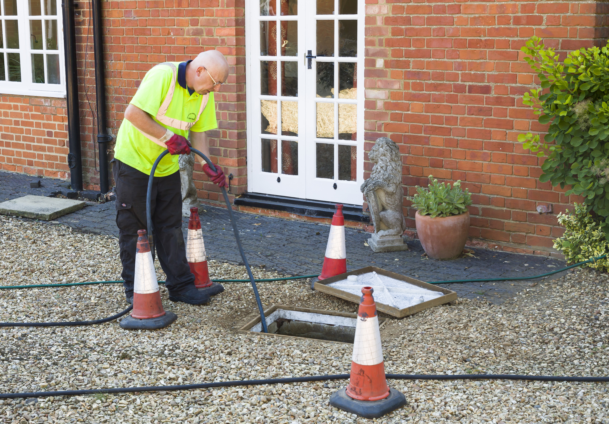 man drain jetting outside a domestic property